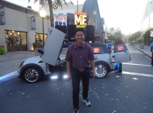 He likes the car. Oliver Yang, tourism marketing specialist in the office of Texas Gov. Greg Abbott enjoys the disco party car enough that he stops to pose in front of it.
