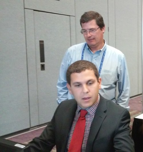 Luiz De Moura (standing), US Travel's managing director, Latin America; and Michael Jacobson, director, grass roots and PAC, use us as a test case for the new ipw registration software. It worked. They let us in.