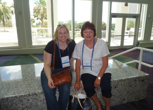 Christine Tremaine (left), marketing and tourism representative, CJF Marketing International, and her CJF colleague, Mindy Suhoza, travel and tourism representative, take a brief rest after setting up their booth.
