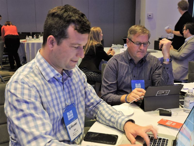 ". Both Bob Schwartz (left), director of marketing and sales, Boston Duck Tours; and Christian Van Meter, manager, group sales, Americas, for the Carlson Rezidor Hotel Group, have laptops and smartphones at the ready as the take a ""work break."""