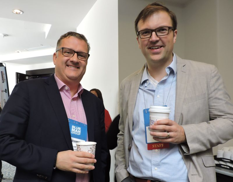 Fueling up with coffee and conversation during the morning coffee break are: (left) Scott Johnson, with the digital media group, Arrivalist; and the NAJ Group's Florian Hermann, moderator of International Digital Day.