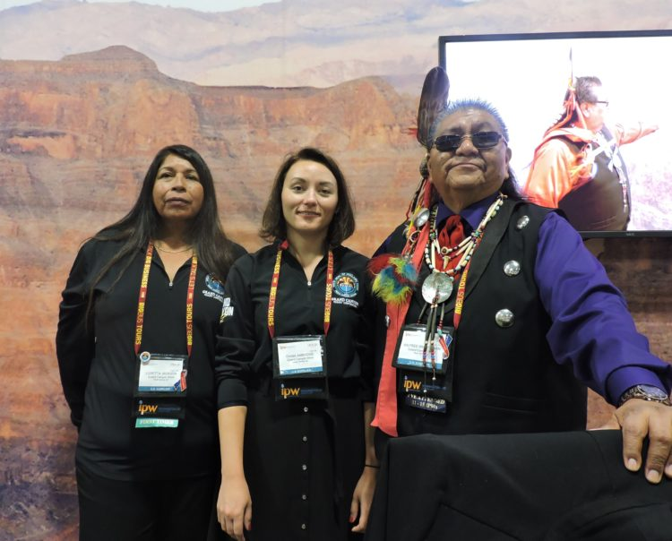 At IPW for the Hualapai Nation (its borders include the famous Skywalk that juts out over the western rim of the Grand Canyon) and Grand Canyon Resort Corporation are: Loretta Jackson (left); Diana Ambrosie, general manager, Hualapai Lodge and Diamond Creek Restaurant; and Wilfred Whatoname.