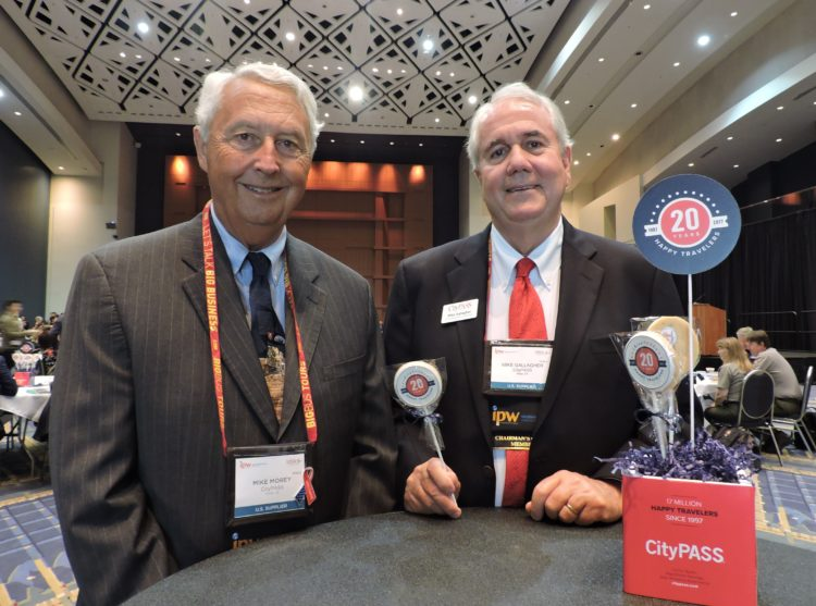 Celebrating the 20th birthday of CityPass, sponsor of the IPW International Media Marketplace, are co-founders and co-chairmen of the company, Mike Morey (left); and Mike Gallagher.