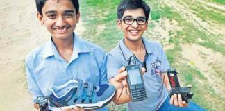 Anand Gangadharan left and Mohak Bhalla with their portable shoe mobile phone charger