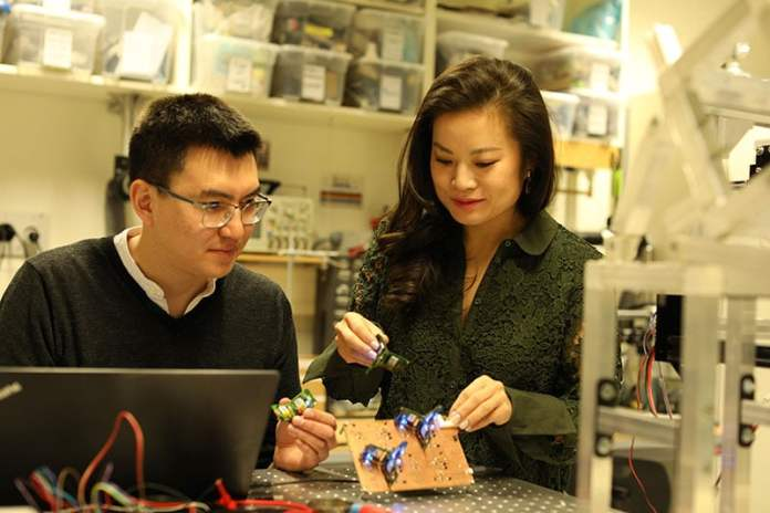 Researchers Zhenishbek Zhakypov and Jamie Paik./ Image: EPFL