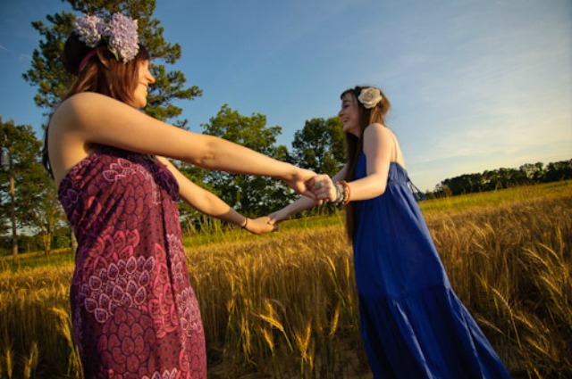 girls-dancing-in-a-field