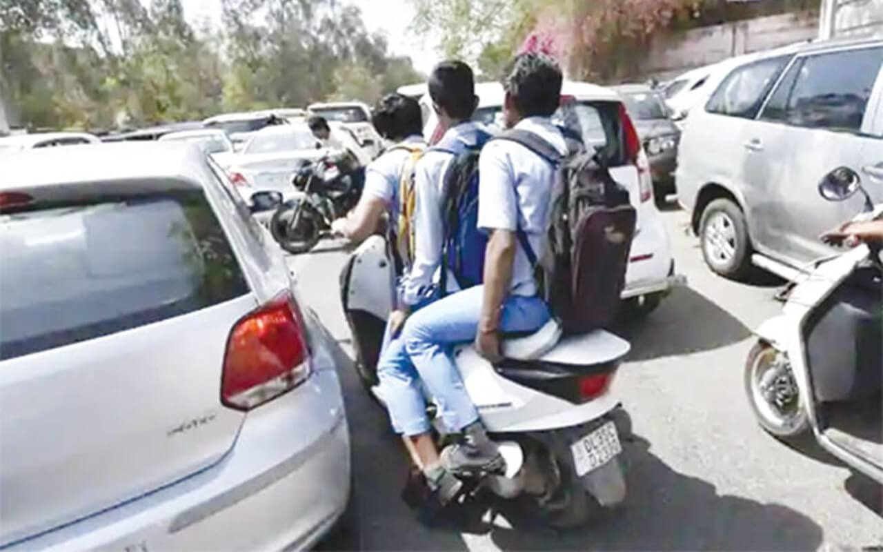 Students Driving Two Wheelers to School