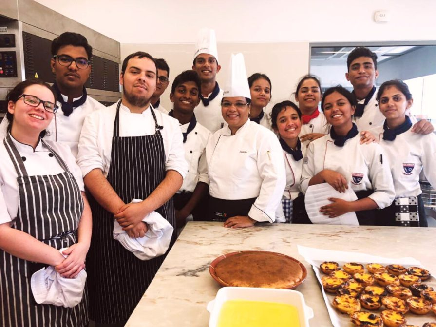 A group picture of VMSIIHE students along with Chef Sujatha Madhavan in the kitchen