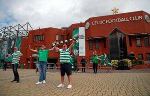 Celtic fans celebrate outside Celtic Park after Celtic were crowned champions of the Scottish Premiership