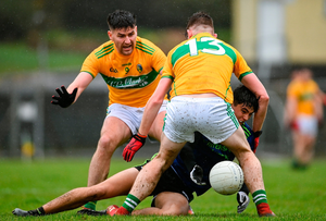 Tommy Conroy of Mayo is attacked by Domnnaill Flynn (left) and Shane Quinn of Leitrim during the Connacht GAA Football Senior Championship quarterfinal match between Leitrim and Mayo at Avantcard Páirc Sean Mac Diarmada in Carrick-on-Shannon, Leitrim. Photo: Ramsey Cardy / Sports File