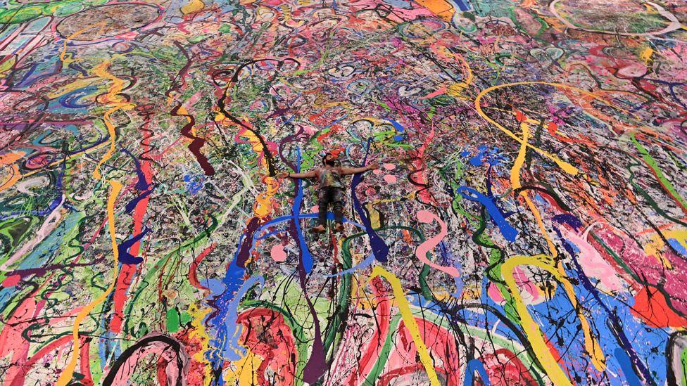 World's largest painting raises £45m for children's charities