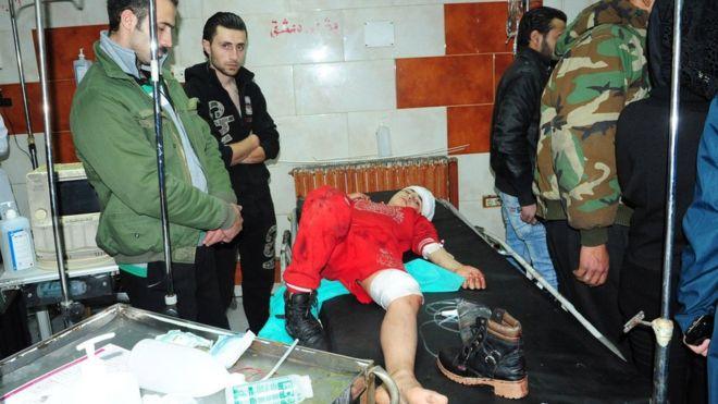 Syria war: Dozens killed as rockets hit Damascus market