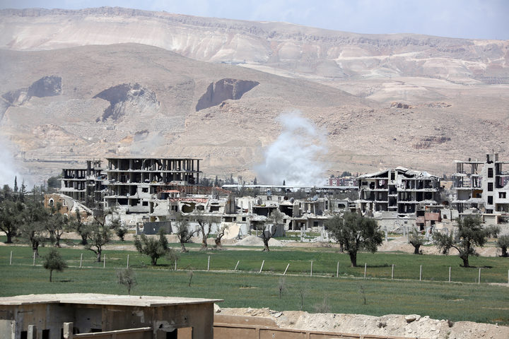 Syria conflict: Strikes hit Syrian airfield, state media report