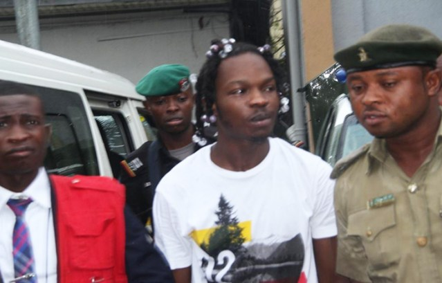 Image result for images of Naira Marley's phone in cyber fraud trial