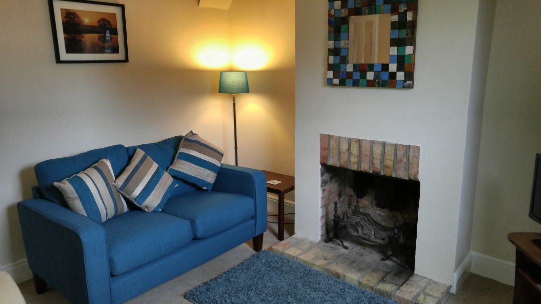 cosy living room with log burner leather sectional sherston cottage dog friendly retreat in the new forest sleeps 4 sitting which now has a clearview installed