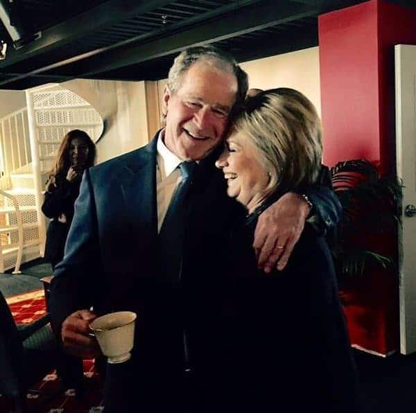 George Bush hugs Hillary at Nancy Reagan's funeral.
