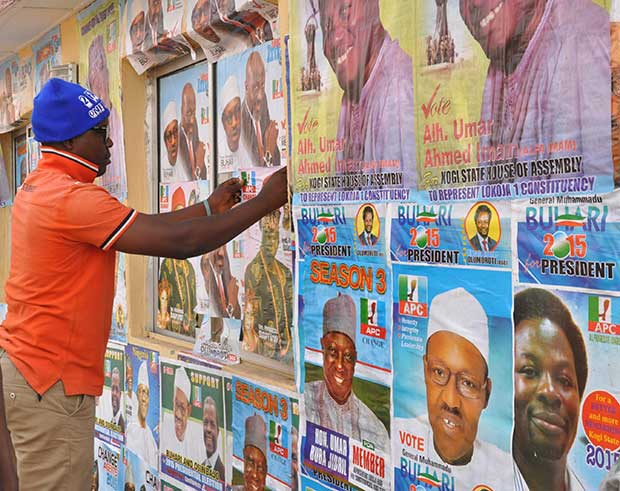 Walls are plastered with campaign posters ahead of the 14 Feb elections in Nigeria. (Heinrich-Böll-Stiftung/Flickr)