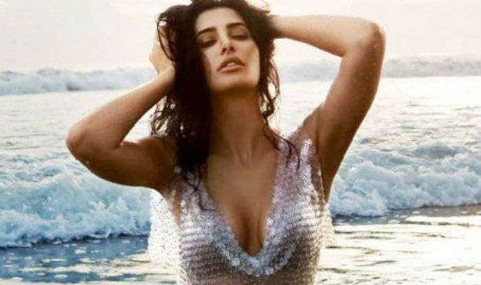 Nargis Fakhri Flaunts Sexy Cleavage In Hot Sparkling