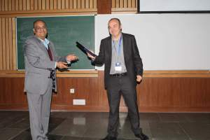 Brejesh Lal presenting a memento to Prof Laurent at Developers tutorial in Delhi