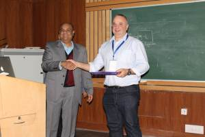 Brejesh Lal presenting a memento to Thierry at Developers tutorial in Delhi