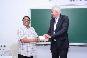 Klaus Pendl presents a memento to PJ Narayanan at Developers tutorial in IIIT Hyderabad