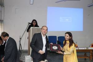 Roopali presenting a memento to Prof Laurent at Developers tutorial in Panjab University