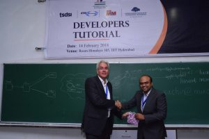Sachin Chaudhari presents a memento to Pendl Klaus at Developers tutorial in IIIT Hyderabad