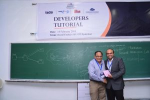 Sachin Chaudhari presents a memento to Vijay Madan at Developers tutorial in IIIT Hyderabad