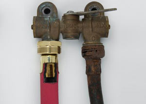 Two washer hoses, one of them our heavy duty FloodChek® hose, next to an old, rusty rubber washing machine hose.