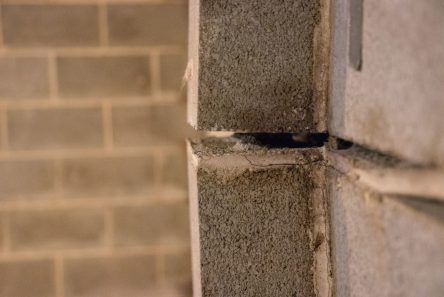 Close up of bad bowing bricks and wall gap