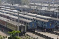 Parked passengers trains are seen at a railway station in Mumbai