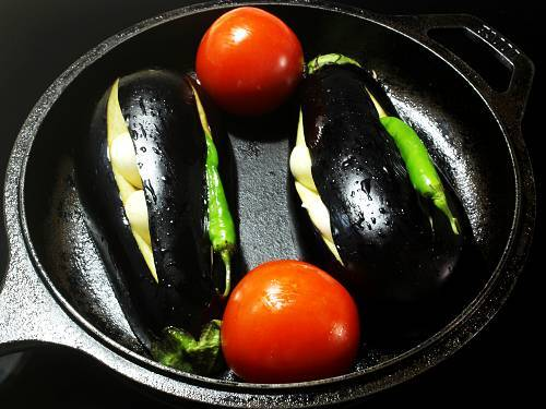 garlic chilli studded eggplants ready for broiling in oven