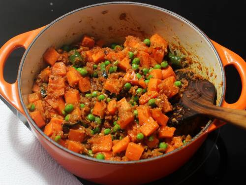 stir frying carrot and peas
