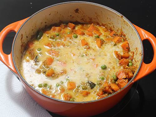 add coconut milk to make carrot curry