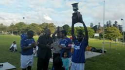 Eid Soccer Club Cup- Ponsonby Team with the Trophy
