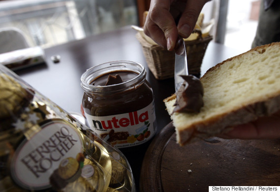 A woman spreads Nutella on a slice of bread in Milan