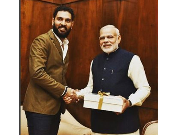 yuvraj-singh-inviting-narendra-modi-IndianWeddingCards