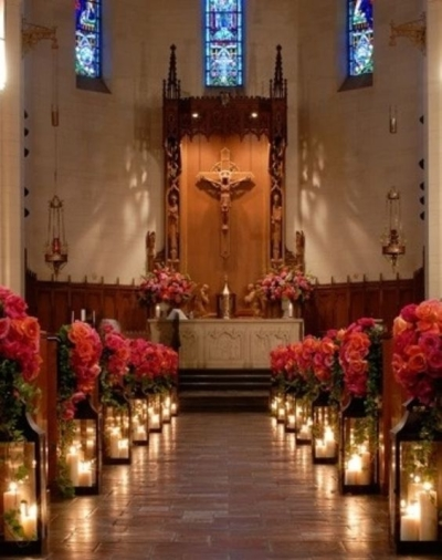 Candles and colourful flowers - Aisle Decoration Ideas