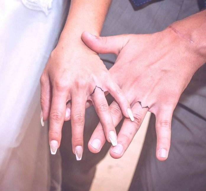 wedding ring tattoo sign