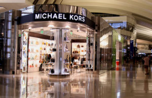 Michael Kors to shutter 100 to 125 full-price stores over two years