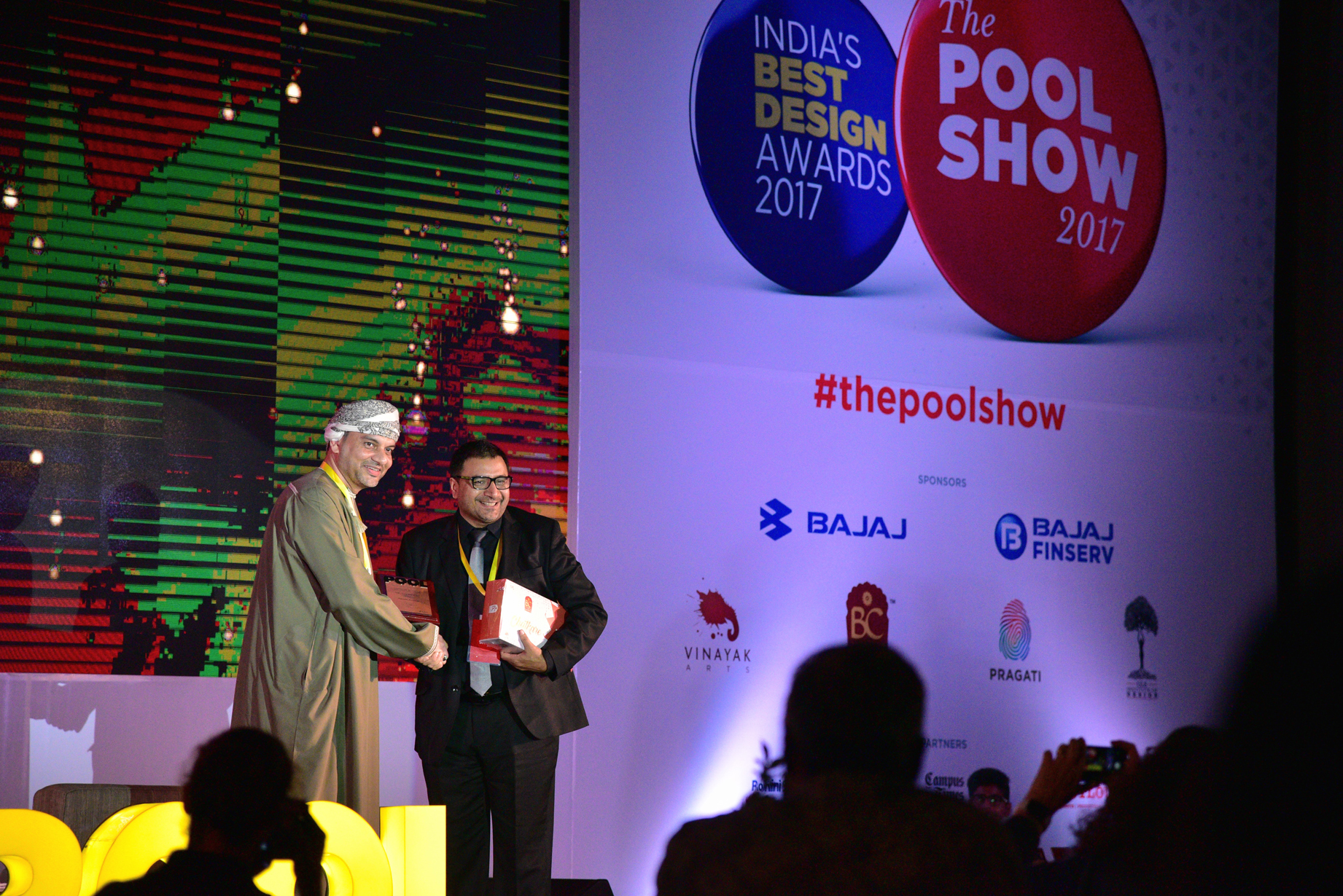 Hussain Al Lawati, receives a memento from Sudhir Sharma, Founder and Editor-in-chief of POOL Magazine.