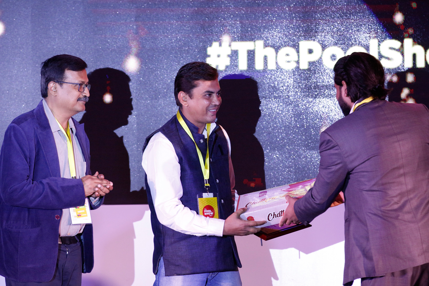A. Balasubramanium, Bhavin Dabhi, and Abhijit Bansod, receive mementos from Deepak Gautam, Head of Finance at INDI Design and POOL Magazine.