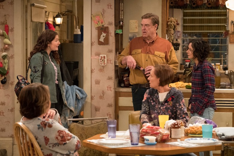 """ROSEANNE - """"Roseanne Gets the Chair"""" - Roseanne's clash with Darlene over how she's raising her kids - especially Harris - reaches a breaking point; while Dan tries to help Roseanne with her bad knee by getting her an elevator chair, which she refuses to use because she doesn't want to admit getting old, on the second episode of the revival of """"Roseanne,"""" TUESDAY, APRIL 3 (8:00-8:30 p.m. EDT), on The ABC Television Network. (ABC/Adam Rose)ROSEANNE BARR, EMMA KENNEY, JOHN GOODMAN, LAURIE METCALF, SARA GILBERT"""