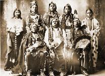 Tonkawas: (standing left to right) Winnie Richards,  John Rush Buffalo, William Stevens, John Allen,  Mary Richards; (seated left to right) John Williams,  Chief Grant Richards, Sherman Miles.