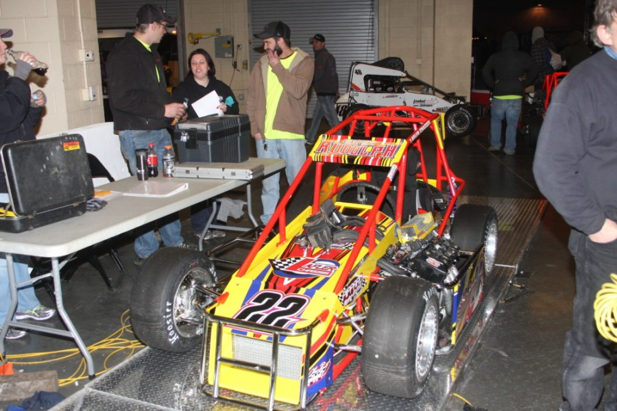 The car of Erick Rudolph goes over the scales to verify he meets the minimum weight requirement.