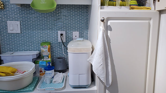 A pumping station in the kitchen with sterilizer and pumping supplies.