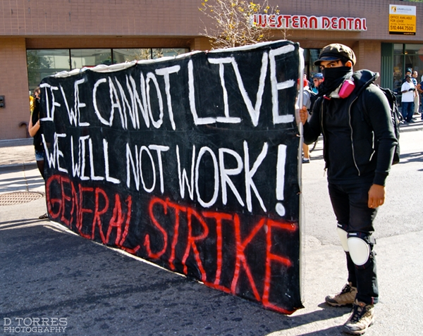 """If we cannot live, we will not work"" banner"