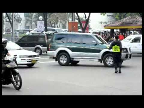 Filipino Traffic Cop Doing His Job…