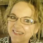 Dina Capek. Headshot