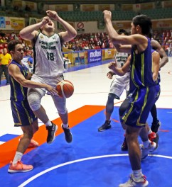 Paul Abi Galinato of UC Web Masters manage to gets the ball from Raul Jancork Cabahug of UV Green Lancers during their game in CESAFI 2019 at Cebu Coliseum.UC Web Masters win the game 72-64